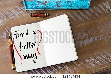 Retro effect and toned image of a fountain pen on a notebook. Handwritten text Find A Better Way as business concept image