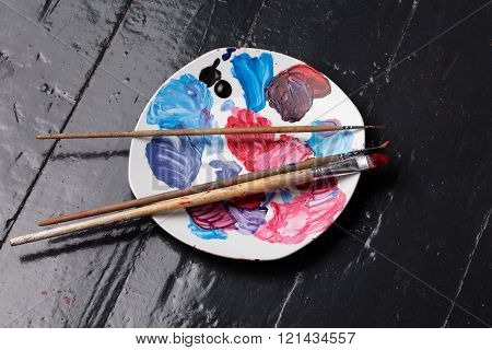 Close Up Brushes And Palette On The Floor