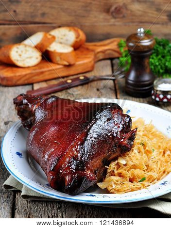 pork knuckle baked in dark beer with mustard and honey