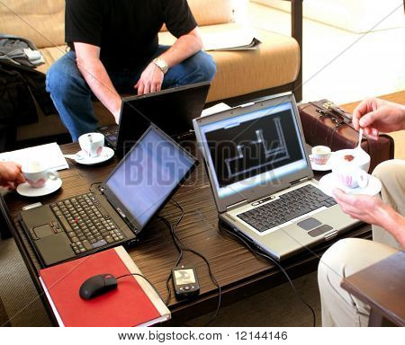 a close up of a three man with a notebook and cappuccino