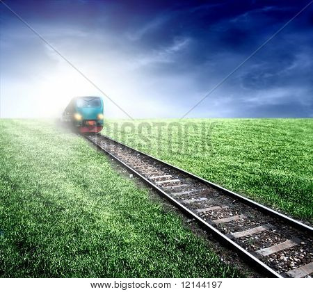 A train, rut and grass