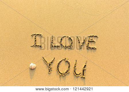 I LOVE YOU - inscription on sand beach.