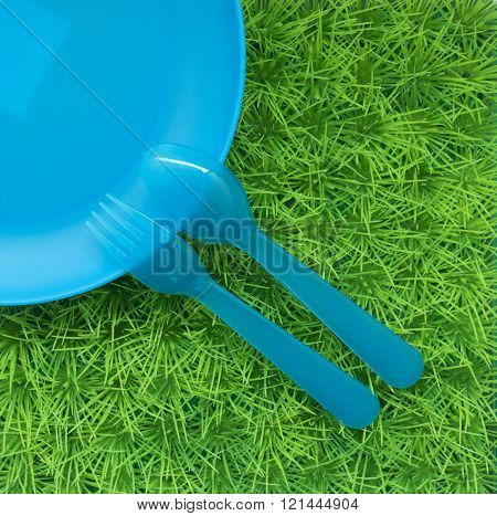 Fun Colored Background With Spoons, Forks , Dish On Green Grass #1