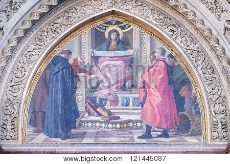 FLORENCE, ITALY - JUNE 05: Charity among the founders of Florentine philanthropic institutions, Left Portal of Cattedrale di Santa Maria del Fiore, Florence, Italy on June 05, 2015
