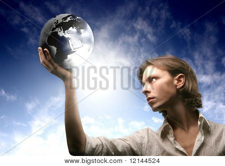a young man with a globe