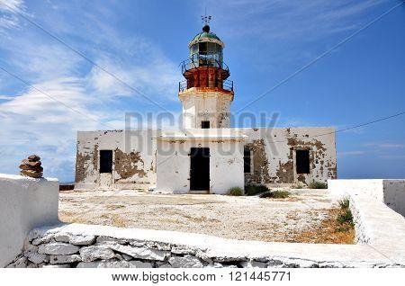 old, deserted and shabby lighthouse on greek island mykonos
