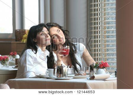 two girl in a breakfast room of hotel