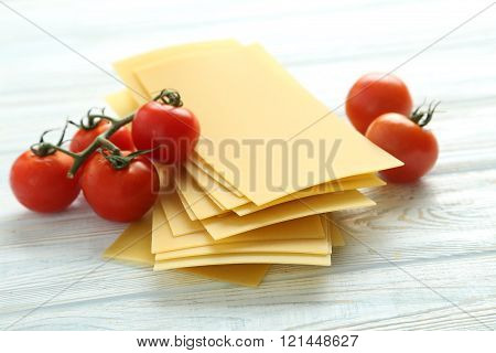 Lasagne Sheets Pasta With Cherry Tomato On A Blue Wooden Table