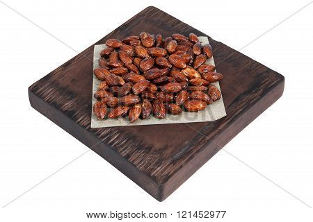 Honey Roasted Almonds On Red Brown Serving Board On White.