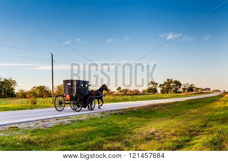Horse and Buggy on a Rural Highway in Oklahoma Amish Country at Sunset