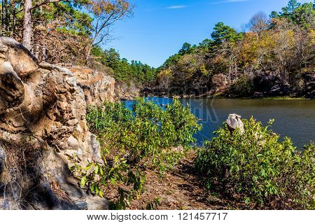 A Tranquil Autumn Outdoor Scene with Large Boulders on Ash Creek at Robbers Cave State Park in Oklahoma.