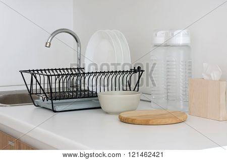 Utensil On White Top Counter Sink