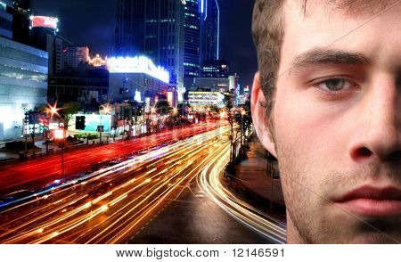 a close up of a man and a street on the night
