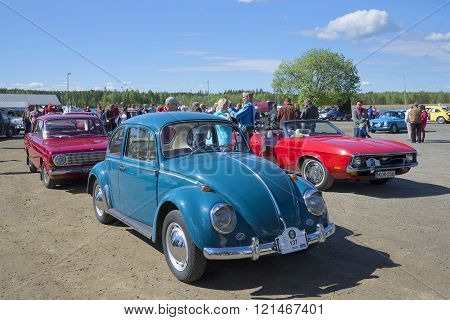 The Volkswagen beetle on the parade of the vintage cars. Kerimyaki, Finland