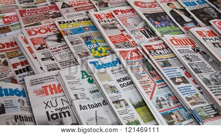 Hanoi, Vietnam - Mar 12, 2016: Many title of Vietnamese newspapers for sale at a news stand in Hanoi capital street.