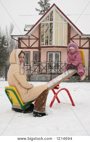 Mother With Baby On The Seesaw