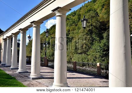 View of the embankment with colonnade of the river Mtsesta Krasnaya Polyana Sochi Russia.