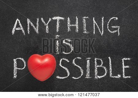 anything is possible phrase handwritten on chalkboard with heart symbol instead of O