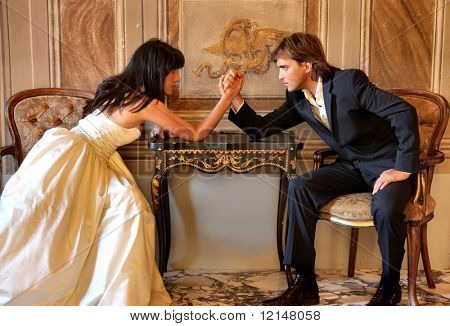 Angry couple battling it off with some arm wrestling