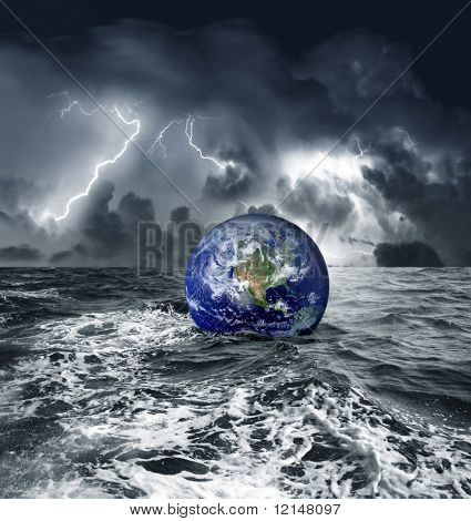 a earth globe sink in the sea