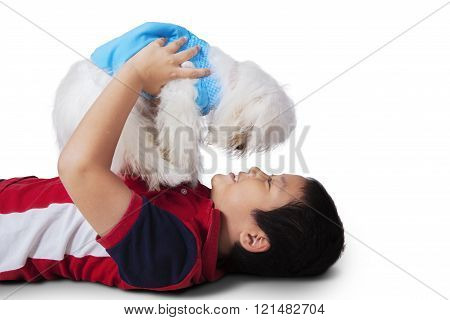 Asian Little Boy Playing Maltese Dog