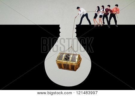 Group Of People Finding A Treasure Chest