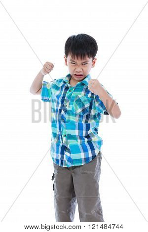 An Aggressive Asian Child. Boy Looking Furious. Negative Human Face Expressions Concept.