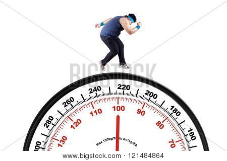 Obese Person Running Above Scale