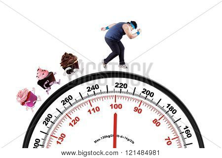 Overweight man runs above scale