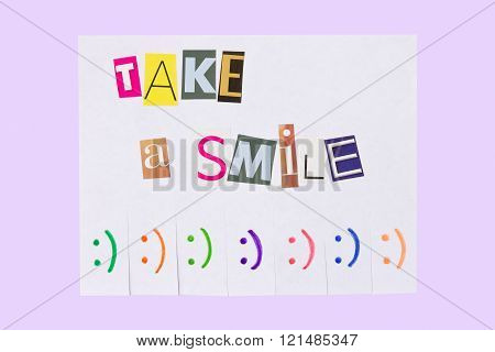 A paper ad with the phrase: Take a Smile and with smile signs ready to be tore off