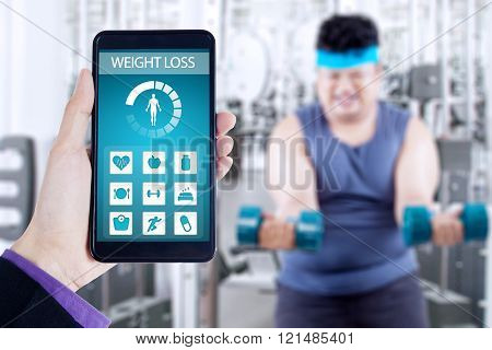 Weight loss app and overweight person