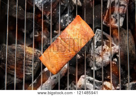 Grilled salmon steak on the flaming.