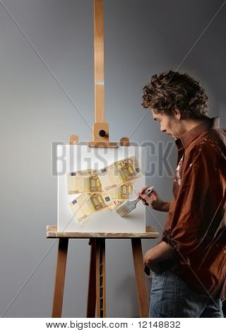 young man painting money on a canvas