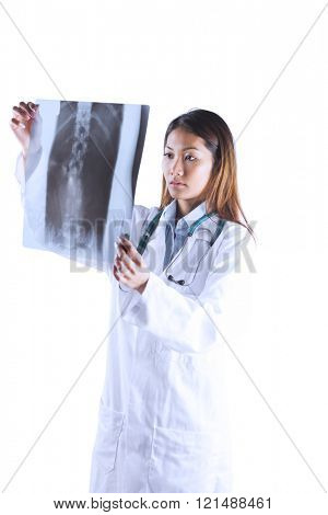 Asian doctor checking MRI scan on white background
