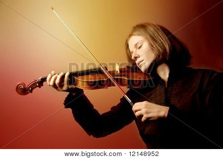 Young attractive woman playing violin