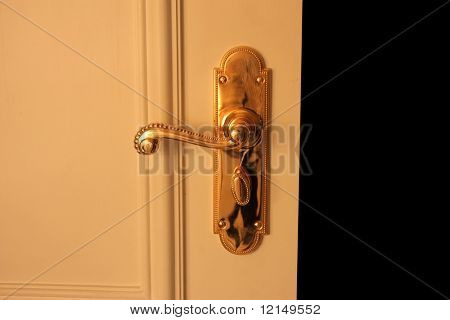 Detail of a an open door whit lock handle
