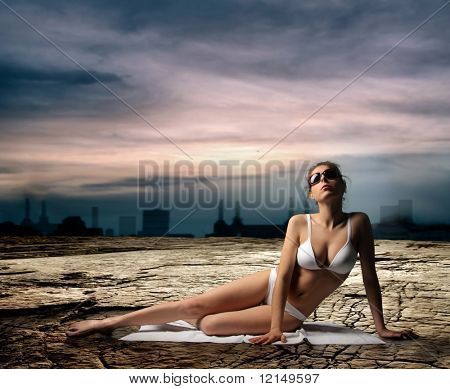 woman in swimsuit on the arid ground