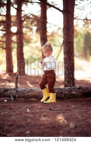 Child girl walking in wood