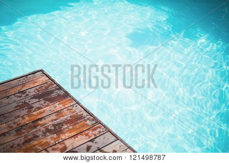 Close-up of wooden deck near swimming pool