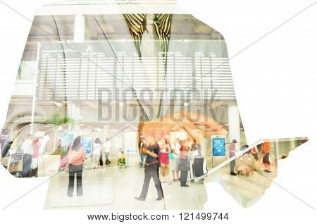 Double exposure of a businessman and a city using a tablet with Flight Schedule Board