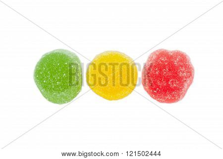 Three Multi Colored Fruit Jelly Candies On A Light Background