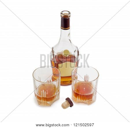 Bottle Of Whiskey And Two Glasses With Whiskey