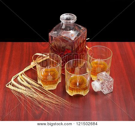 Decanter And Three Glasses With Whiskey, Several Barley Spikes