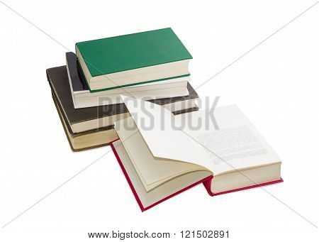 Open Book And Stack Of Several Different Books