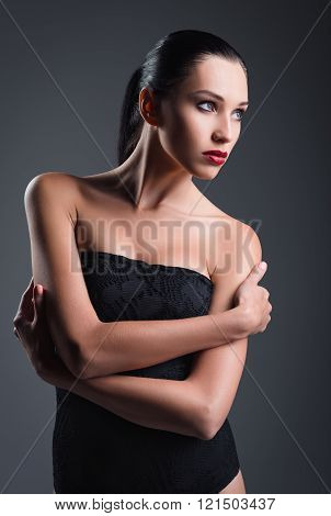 Studio Fashion Shot: Gorgeous Young Girl Wearing Black Body