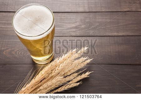 Glass Of Beer And Wheat On The Wooden Background