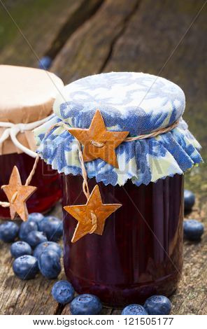 blueberry jam in glasses with cloth domes
