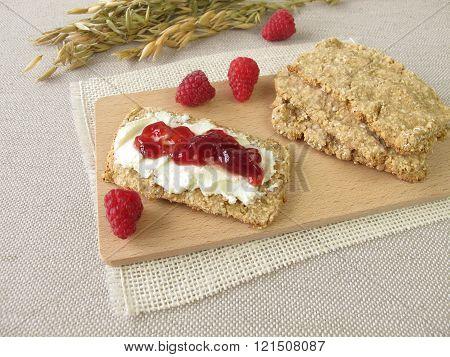 Homemade oats crispbread with raspberry jam