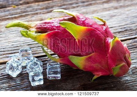 Juicy Pink Pitaya On Wooden Background