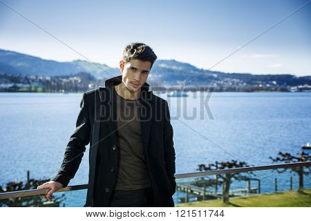 Handsome young man on Luzern lake's shore
